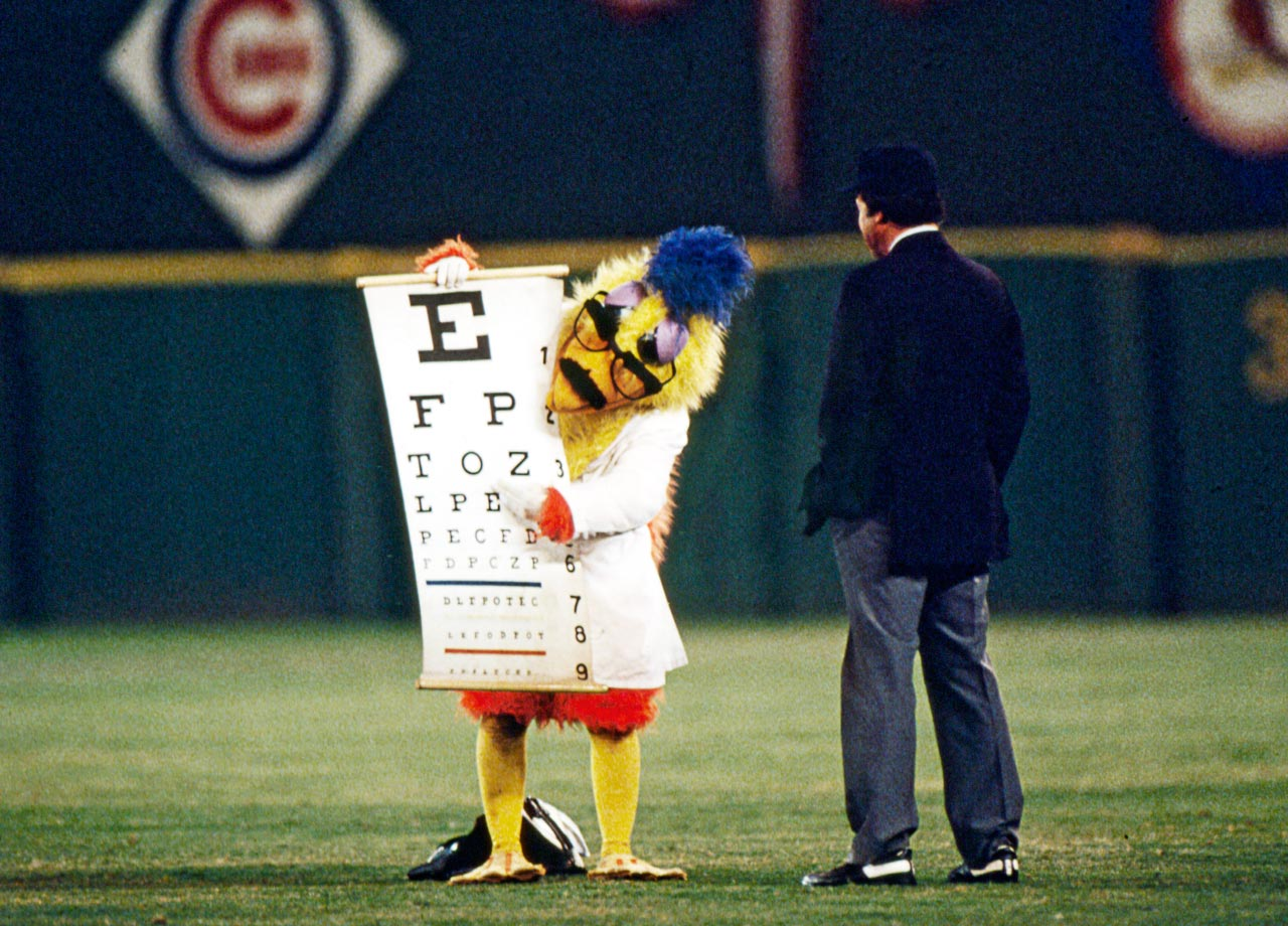 Speaking of chicken, this photo shows the San Diego Chicken administering an eye exam to an umpire during a Padres-Braves game in 1982. Vision, however, was probably the least of the ump's concerns considering he was willing to trust a giant bird with his optometry needs.