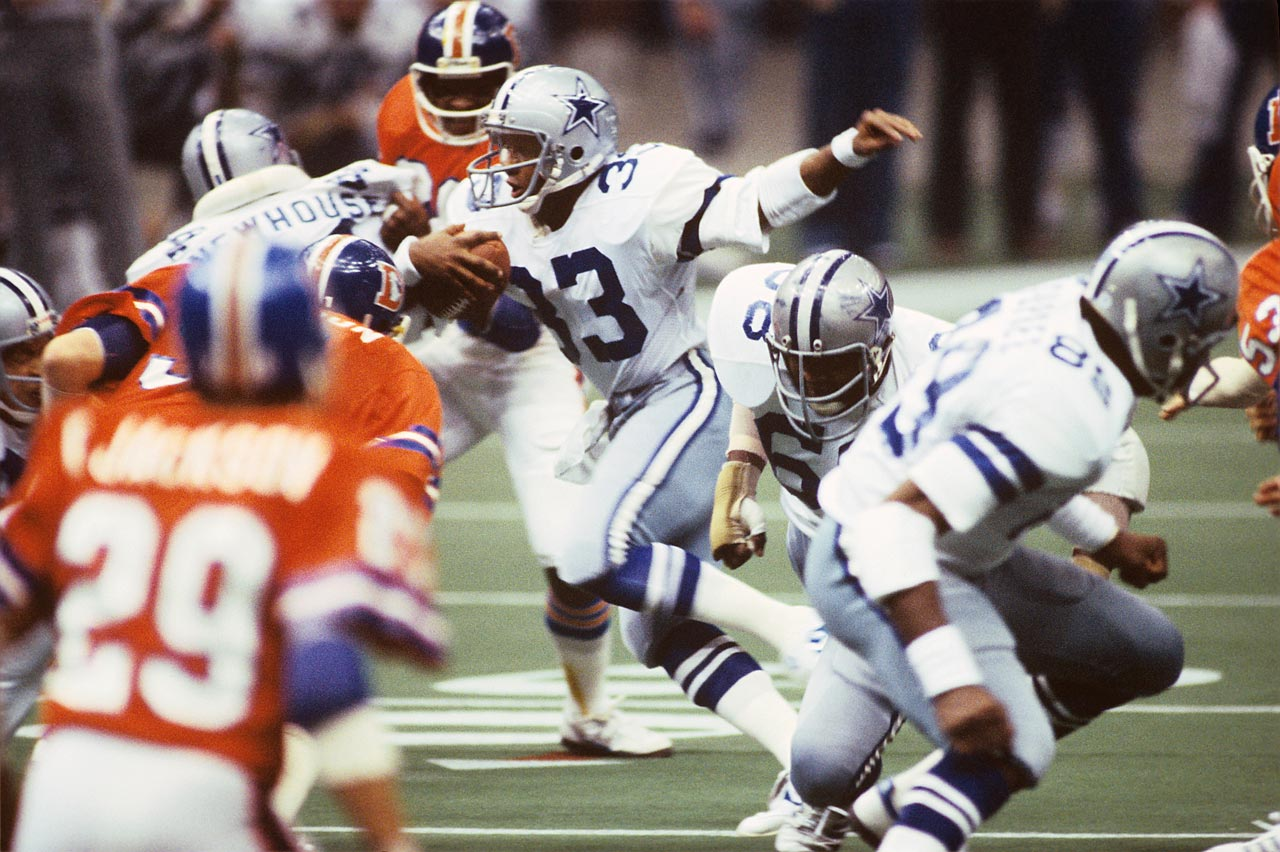 Rookie Tony Dorsett cuts away from a Denver Broncos defender. The Dallas Cowboys running back led all rushers in the game with 66 yards on the ground and a first-quarter touchdown. Dorsett became the first player to win an NCAA championship and a Super Bowl title in back-to-back years in the Cowboys' 27-10 victory.