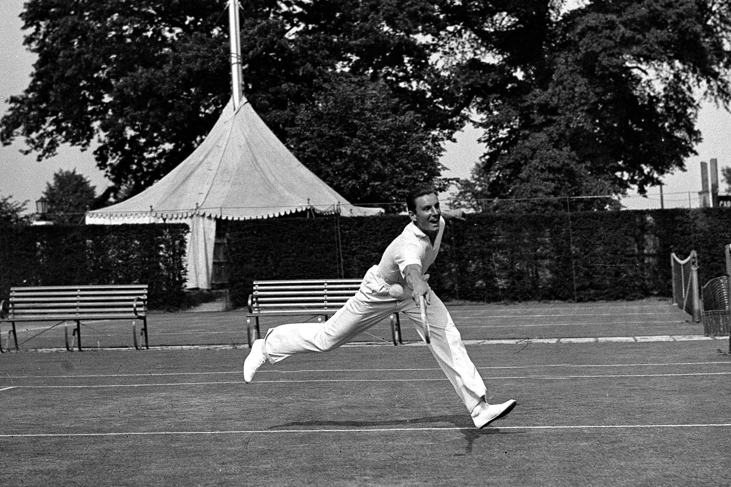 English tennis star Fred Perry training on Wimbledon grass courts in London, England on June 15, 1932.