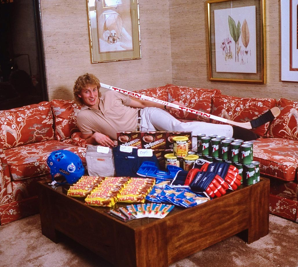 A 20-year-old Wayne Gretzky strikes a goofy pose behind an assortment of products he endorses. The Great One could learn a thing or two about modeling from his daughter, Paulina, whose sultry Instagram shots are infinitely more compelling than her old man's.