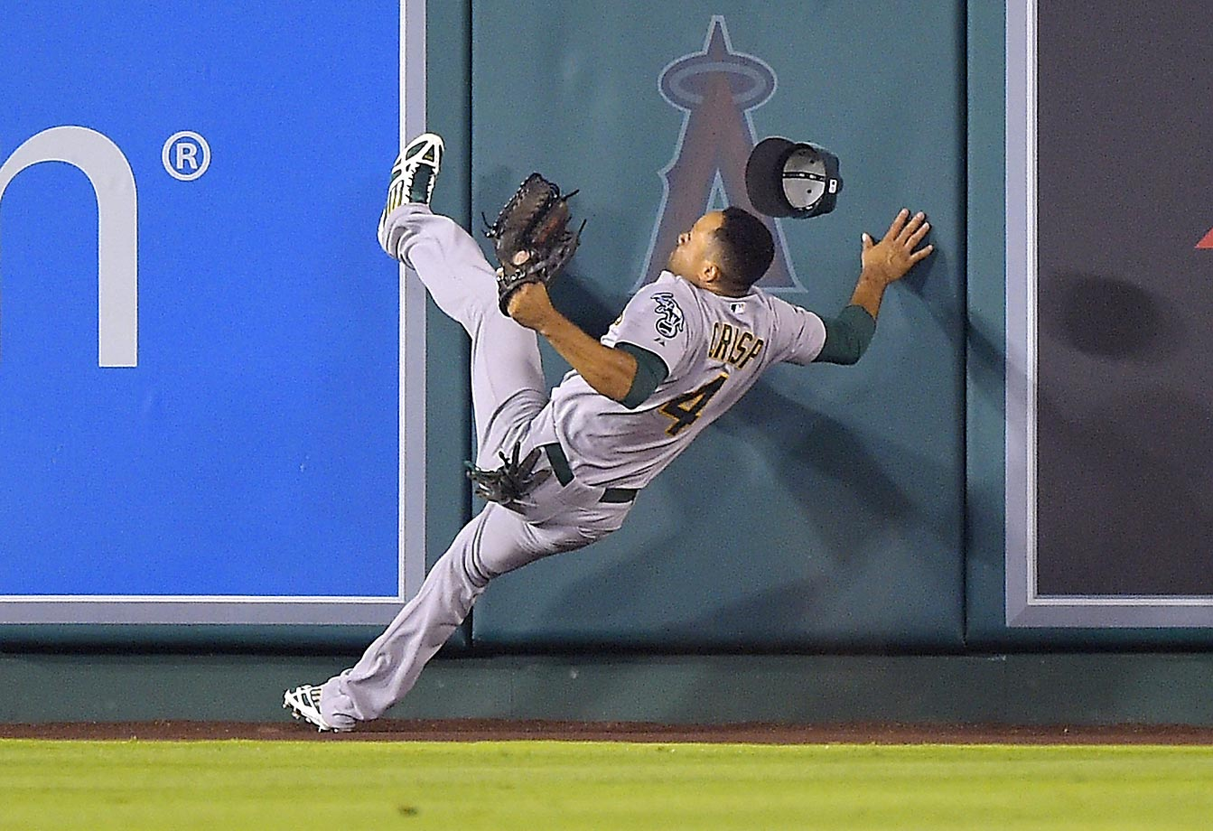 Coco Crisp loses his balance after going to the wall to make a catch.