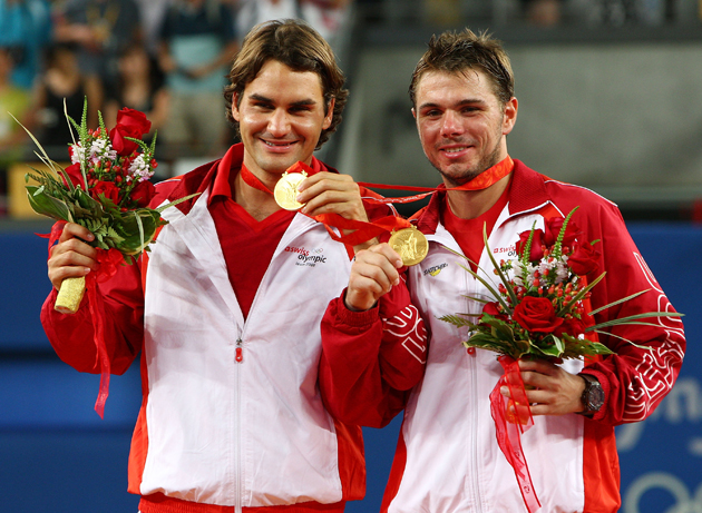 Federer and Wawrinka receive their gold medals after the men's doubles final match.