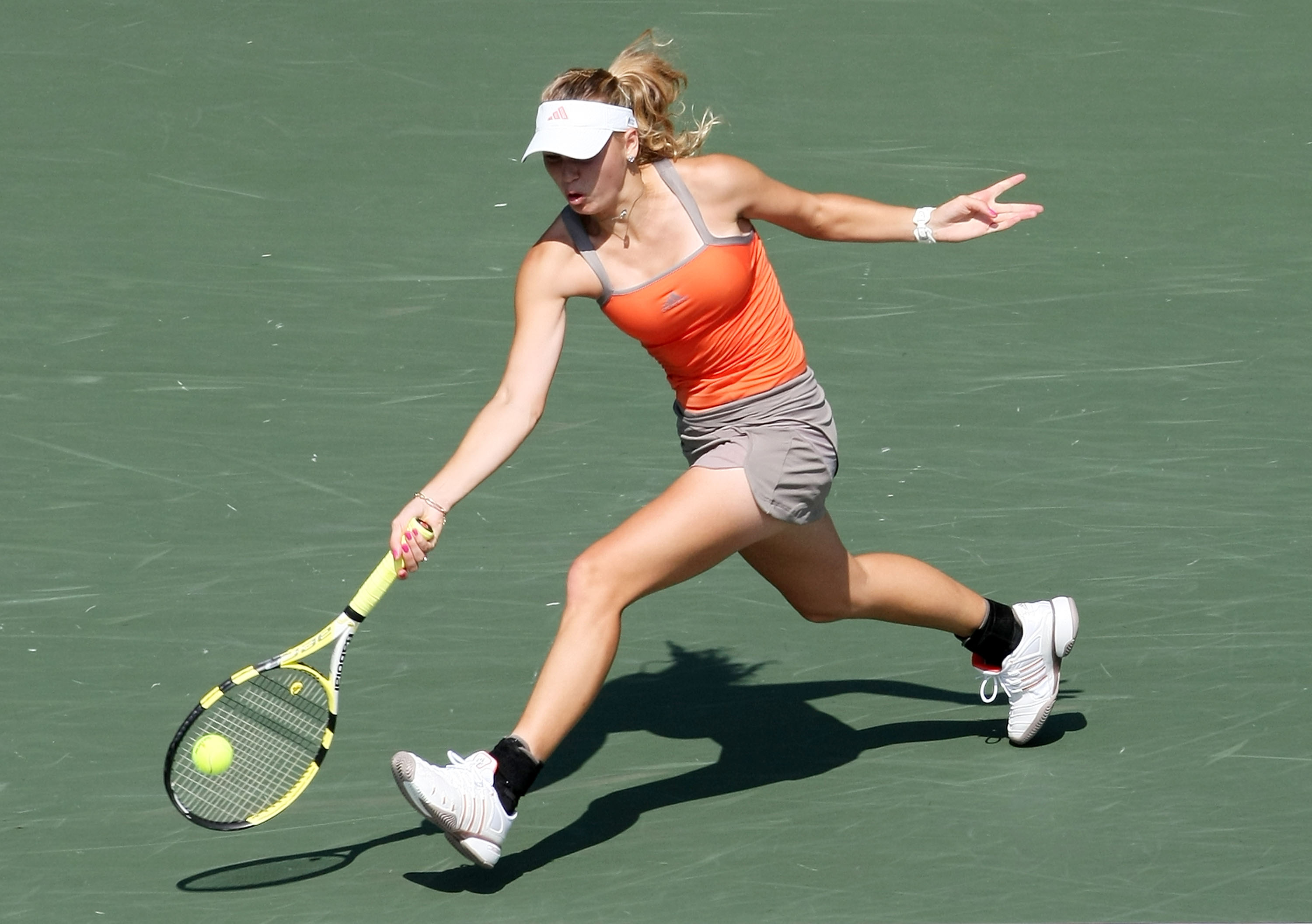 I had a soft spot for Wozniacki's big black ankle braces. They looked like ski boots, which was appropriate because, you know, Danish.
