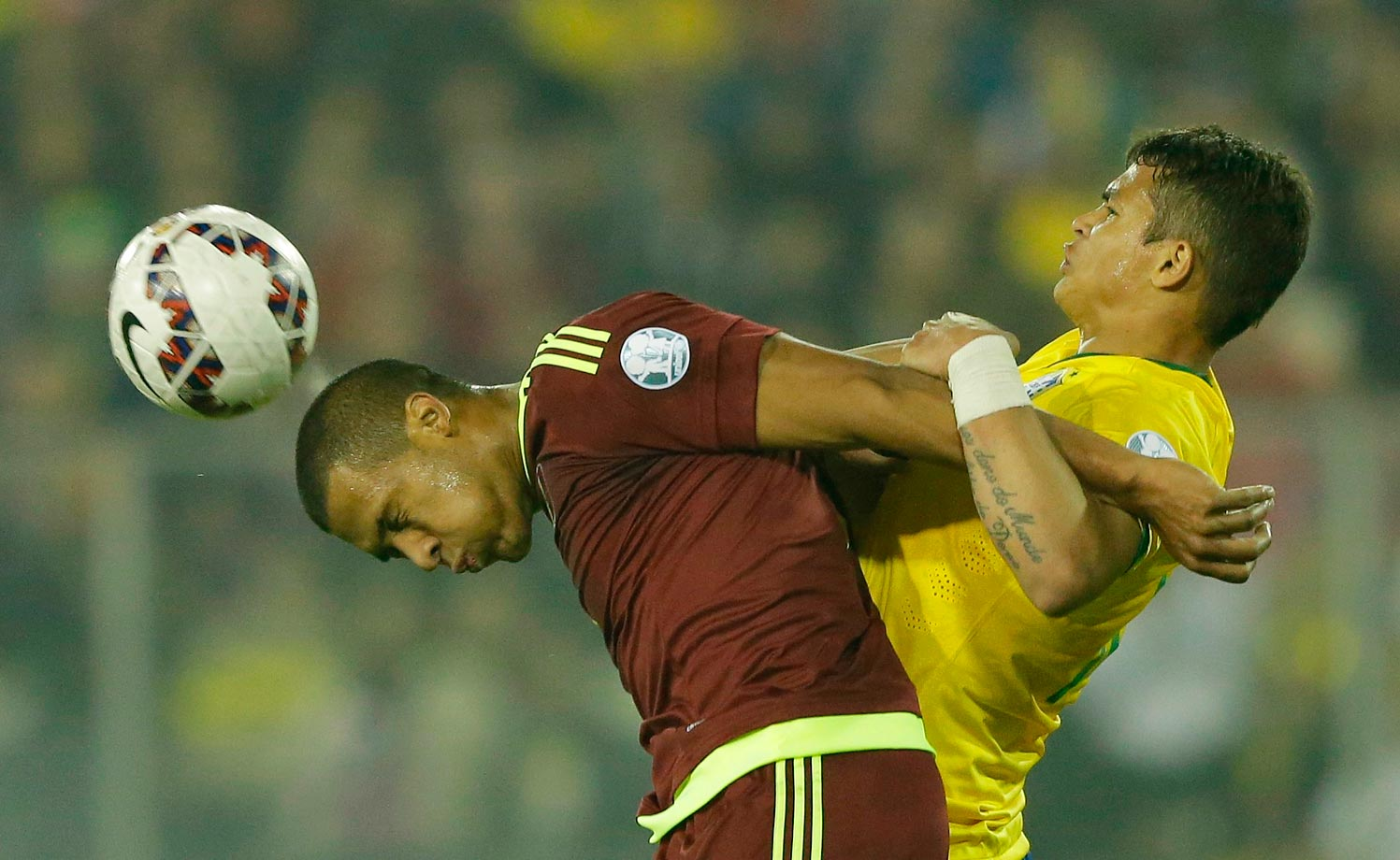 Jose Rondon of Venezuela fights for the ball with Brazil's Thiago Silva during a Copa America Group C soccer match.