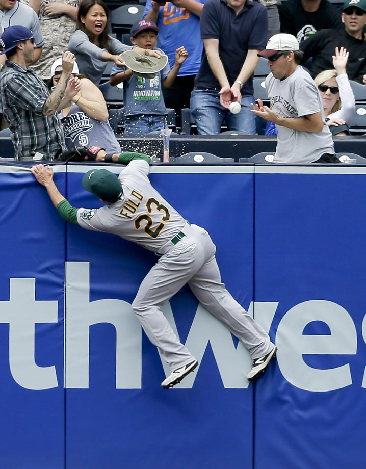 A fan grabs a home run hit by Austin Hedges of the San Diego Padres.