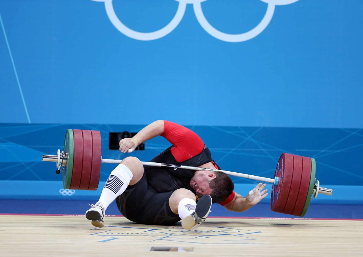 London Olympics, Aug. 7, 2012 | Defending Olympic weightlifting champion Matthias Steiner of Germany lost his balance while trying to lift about 432 pounds and was hit in the neck by the barbell. He got up on his feet and waved to the crowd but later withdrew from the competition.