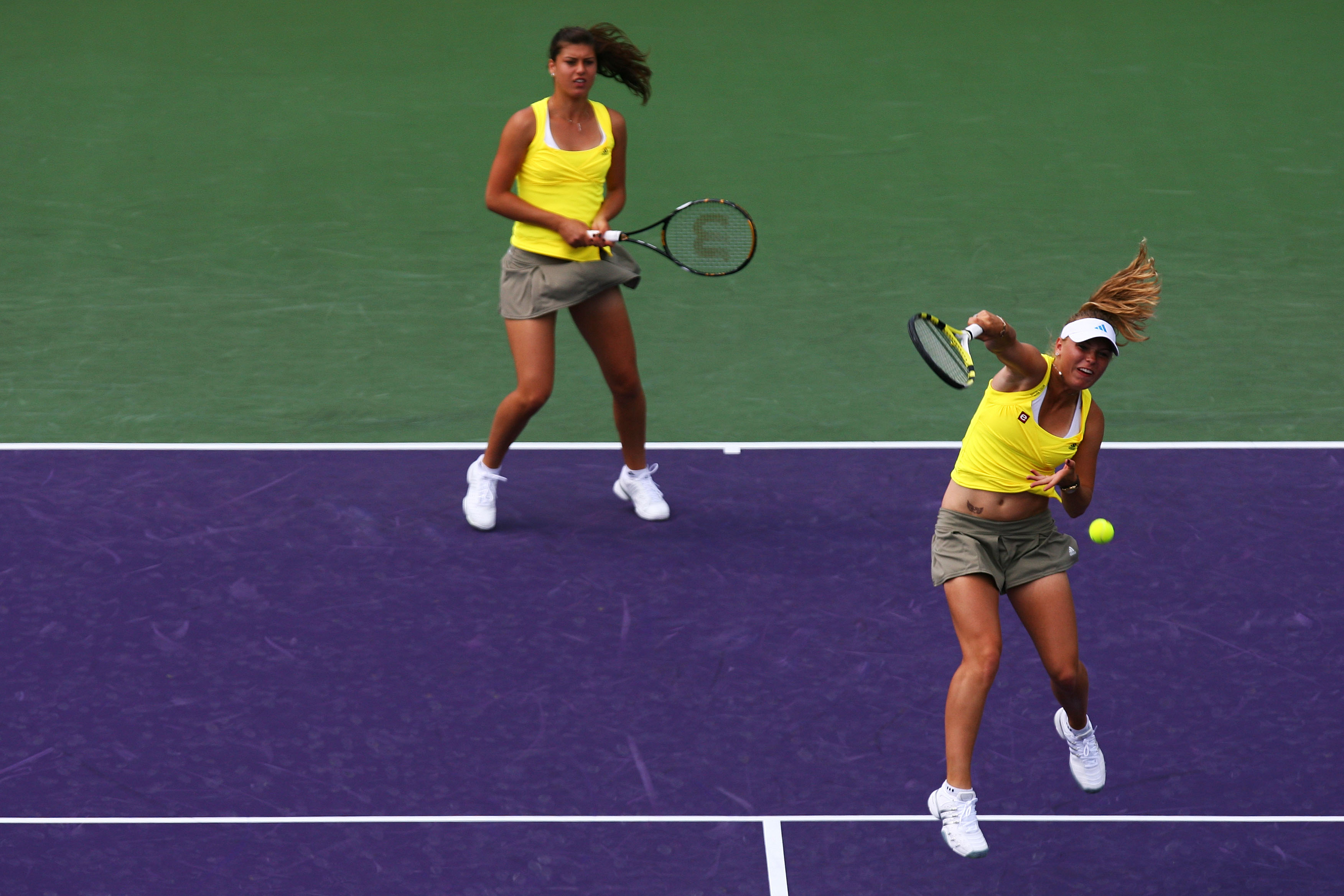 Matching neon safari kits for Wozniacki and her doubles partner Sorana Cirstea. Wozniacki played doubles?