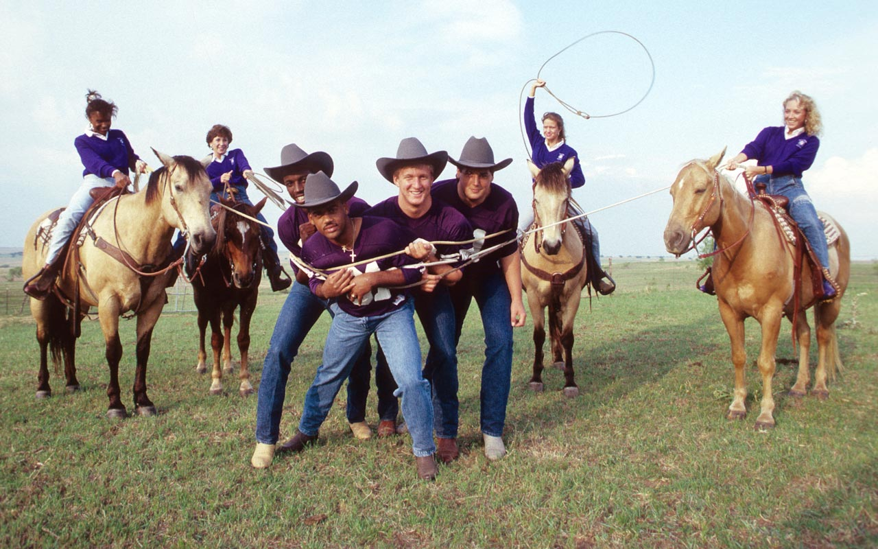 TCU recruits Brett Alexander, Tony Darthard, LeVoil Crump and Chuck Mooney get an unexpected welcome to the Horned Frog family in a 1987 shoot for SI.