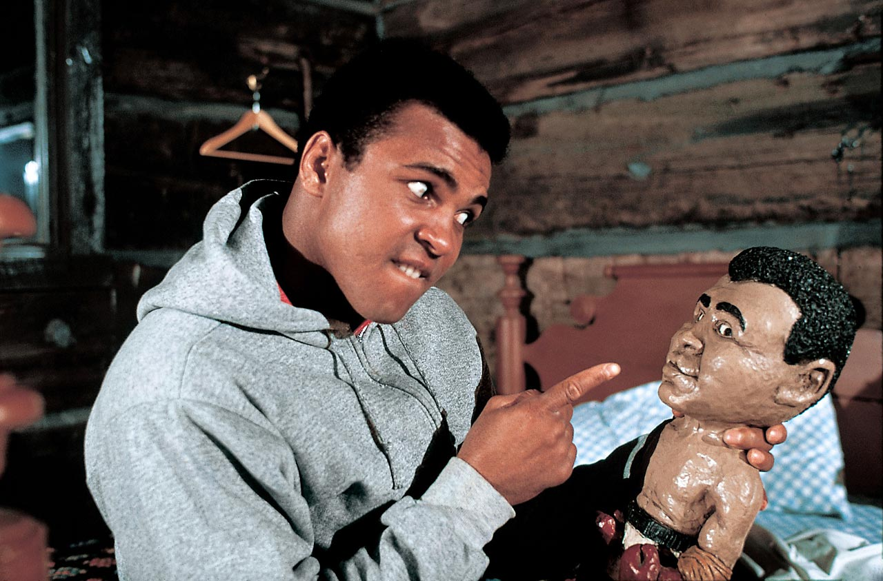 Always his own biggest fan, Muhammad Ali takes a break from training to give props to a much smaller version of himself.