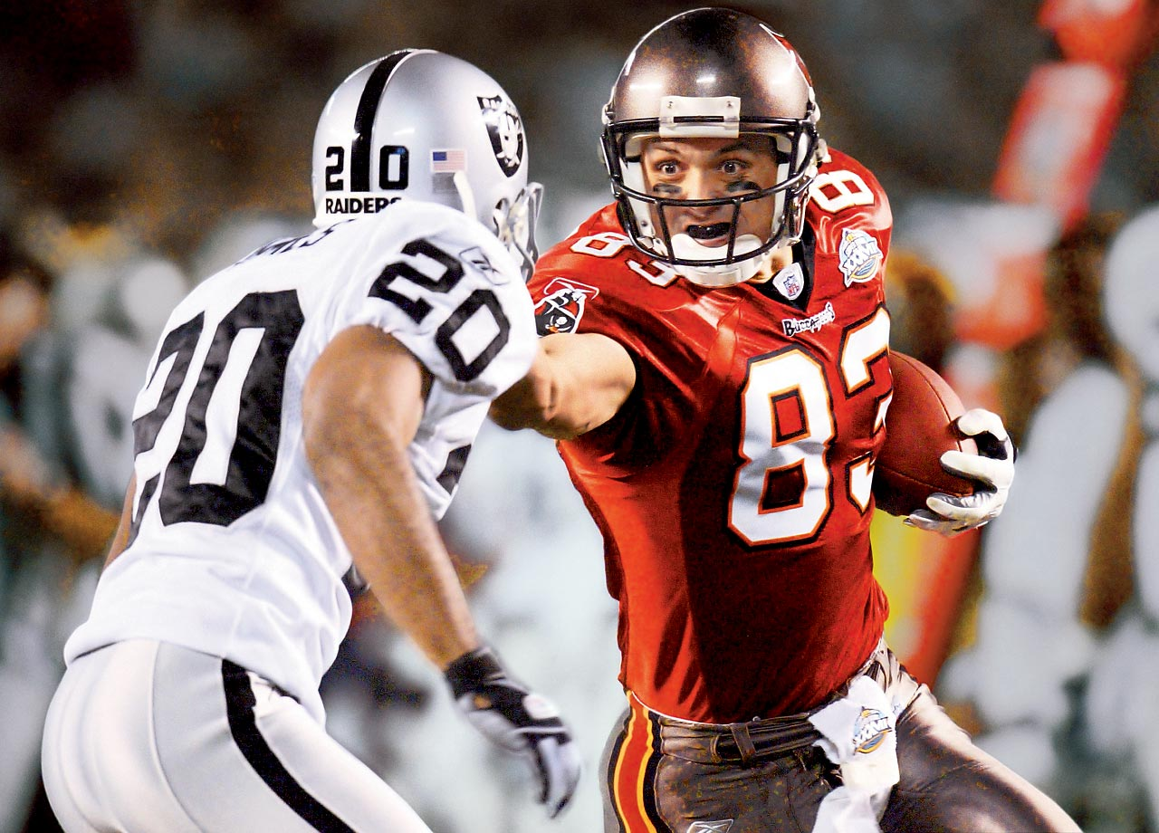 Tampa Bay Buccaneers wide receiver Joe Jurevicius extends a stiff arm at cornerback Tory James in the Bucs 38-21 victory. Jurevicius led all receivers with 78 yards on four catches despite playing with the distraction of his infant son, who was born prematurely five days before the NFC Championship and eventually died in March 2003.