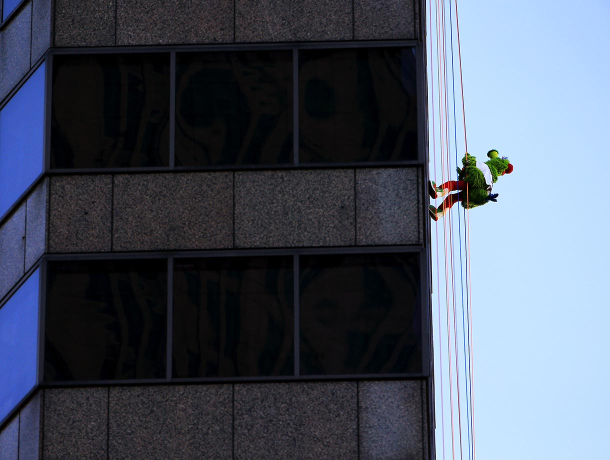 The Phillie Phanatic rappels down a skyscraper as part of an annual fundraiser. The event raises money for the Outward Bound School, which offers outdoor programs aimed at building character and leadership skills.