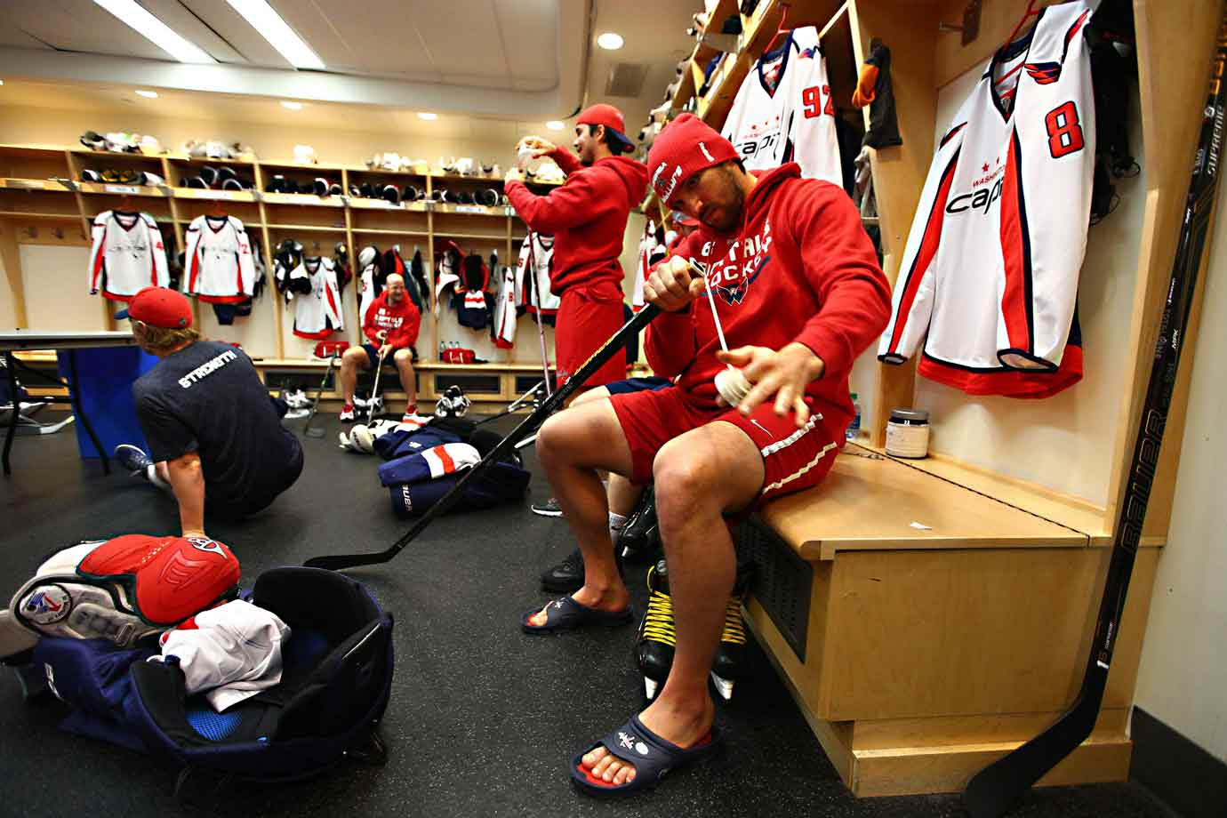 Captain Alex Ovechkin tapes a stick.