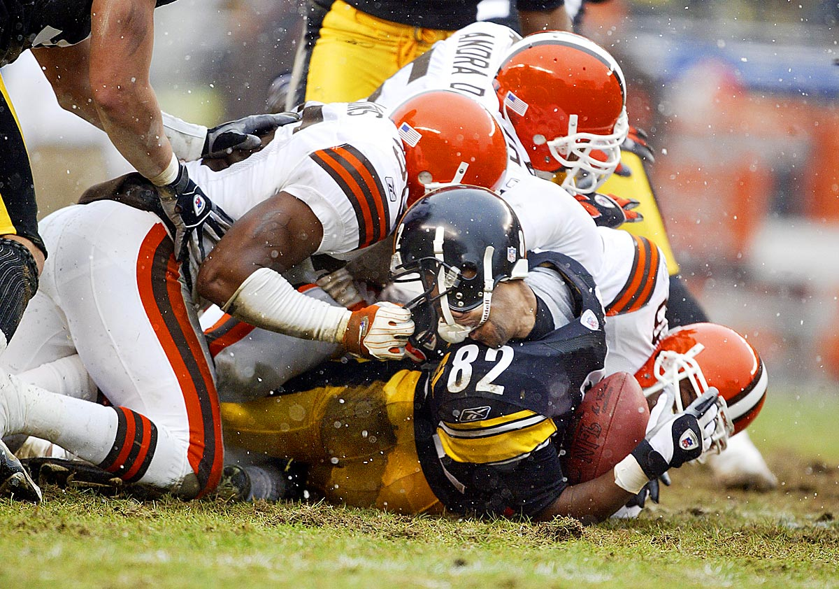 AFC Wild Card playoffs, Jan. 5, 2003 | Pittsburgh receiver Antwaan Randle El has his head turned around as Chris Akins (36) of the Cleveland Browns is called for face masking. The Steelers defeated the Browns 36-33 during the AFC Wild Card Playoff game on Jan. 5, 2003, at Heinz Field in Pittsburgh.