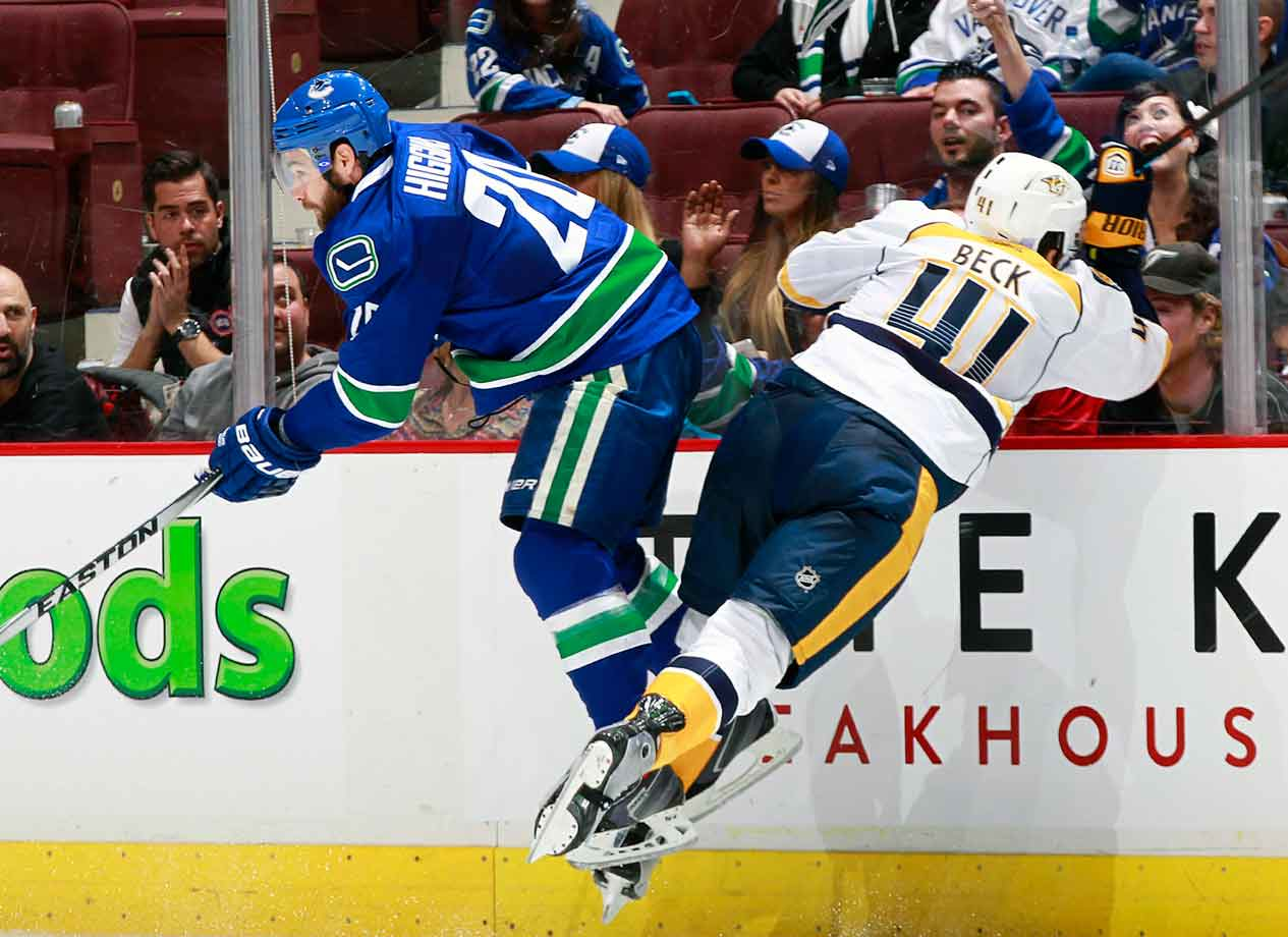 Chris Higgins of the Canucks helps Nashville's Taylor Beck engage in a little face time with the fans at Nashville's Rogers Arena on November 2, 2014.
