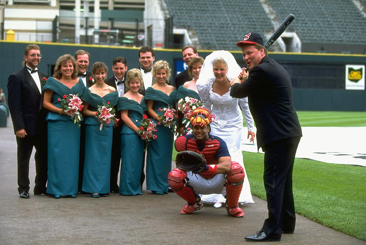 Two Cleveland Indians fans get married at Jacobs Field with the blessing of catcher Sandy Alomar, Jr. If the bride happened to toss her bouquet, it's not a stretch to imagine who here might catch it.