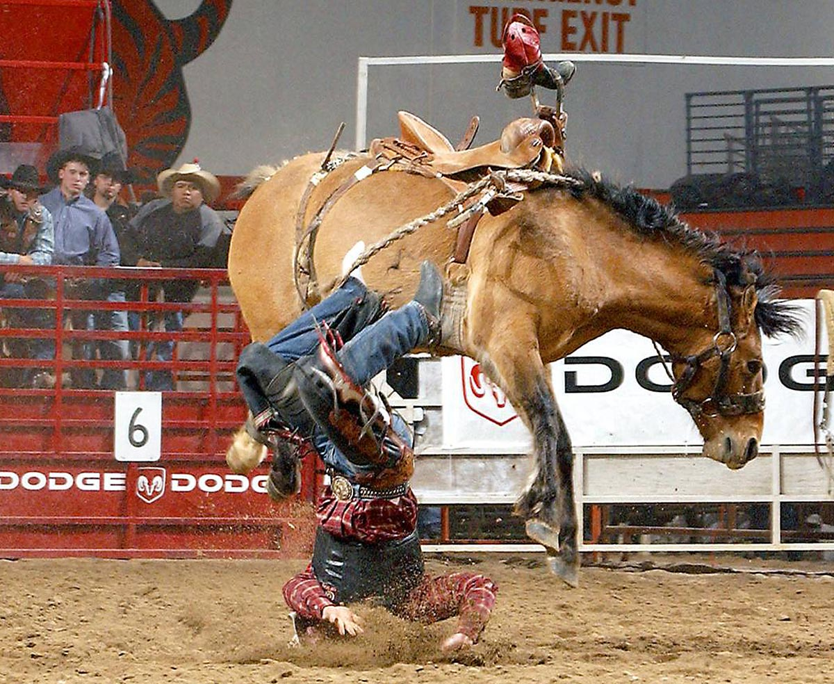Dodge National Circuit Finals Rodeo, March 17, 2005 | Kyle Whitaker of Chambers, Neb., loses his boot as he is bucked off Dump Wagon at the Circuit Finals Rodeo in Pocatello, Idaho. Whitaker would finish 22nd out of 24 competitors in the saddle bronco riding.