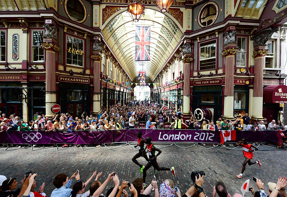 London Olympics, Aug. 12, 2012 | Marathoners Abel Kirui and Wilson Kipsang Kiprotich of Kenya lead Stephen Kiprotich of Uganda through Leadenhall Market at the 2012 Summer Olympics in London.