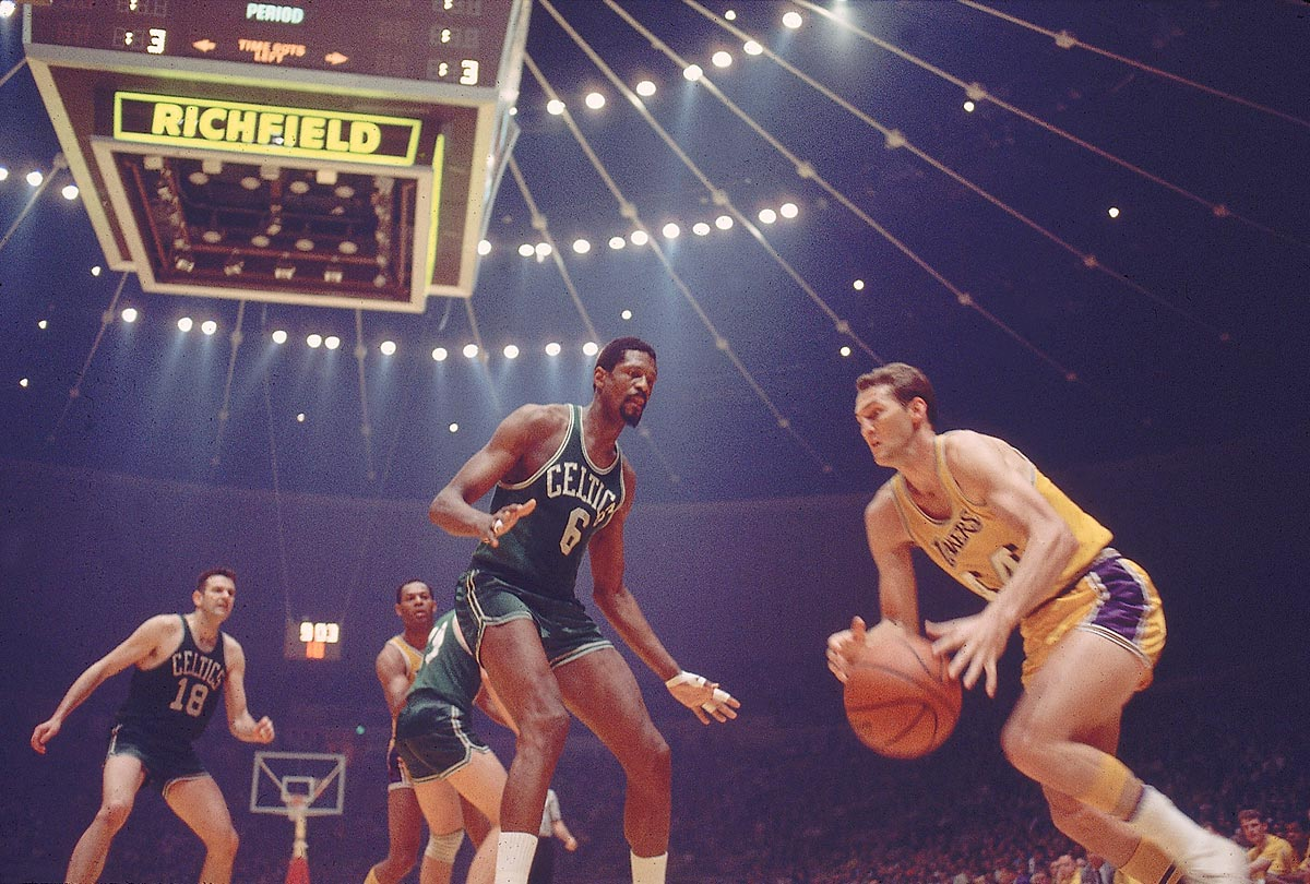 Lakers guard Jerry West drives past Celtics center Bill Russell in Game 6. Boston went on to a 124-109 win at the Forum to clinch the series 4-2.