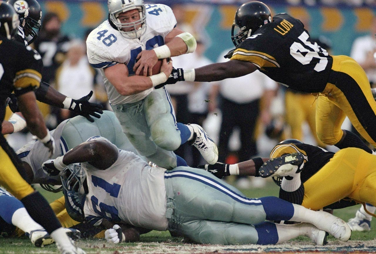 Dallas Cowboys fullback Daryl Johnston hurdles guard Nate Newton on carry. Johnston got just two touches in the game, but the Cowboys defeated the Pittsburgh Steelers 27-17 to earn their fifth Super Bowl win.