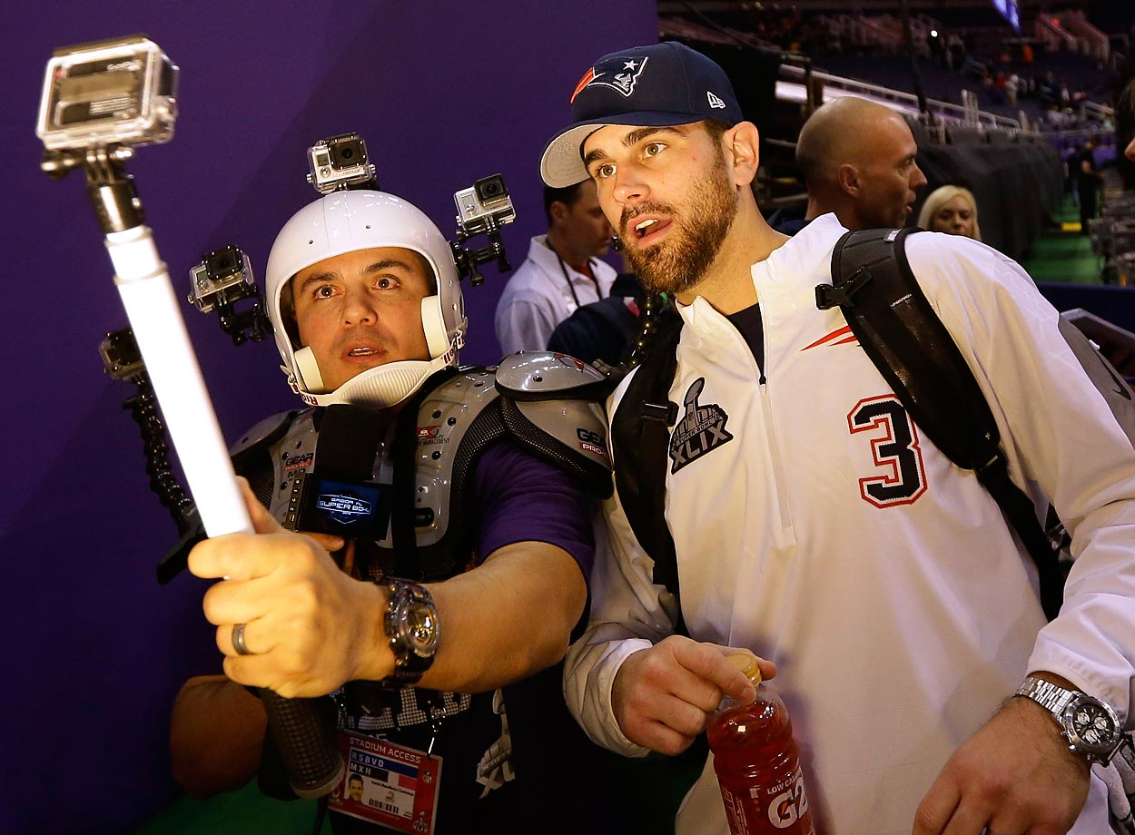 New England Patriots kicker Stephen Gostkowski poses for a selfie with NBC Sports' Karim Mendiburu Contreras during media day.