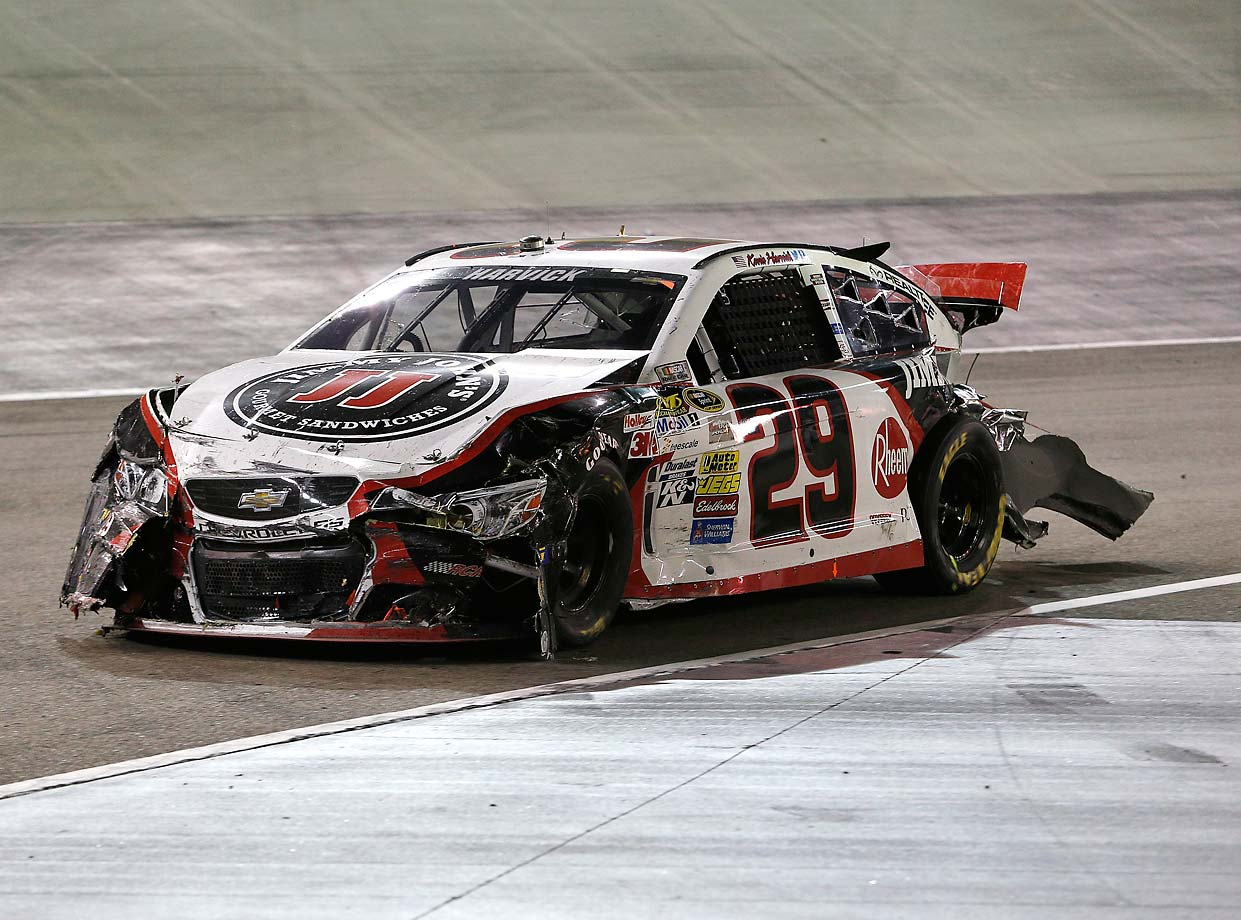 Kevin Harvick brings his damaged race car to the garage during a 2014 race at Bristol Motor Speedway.