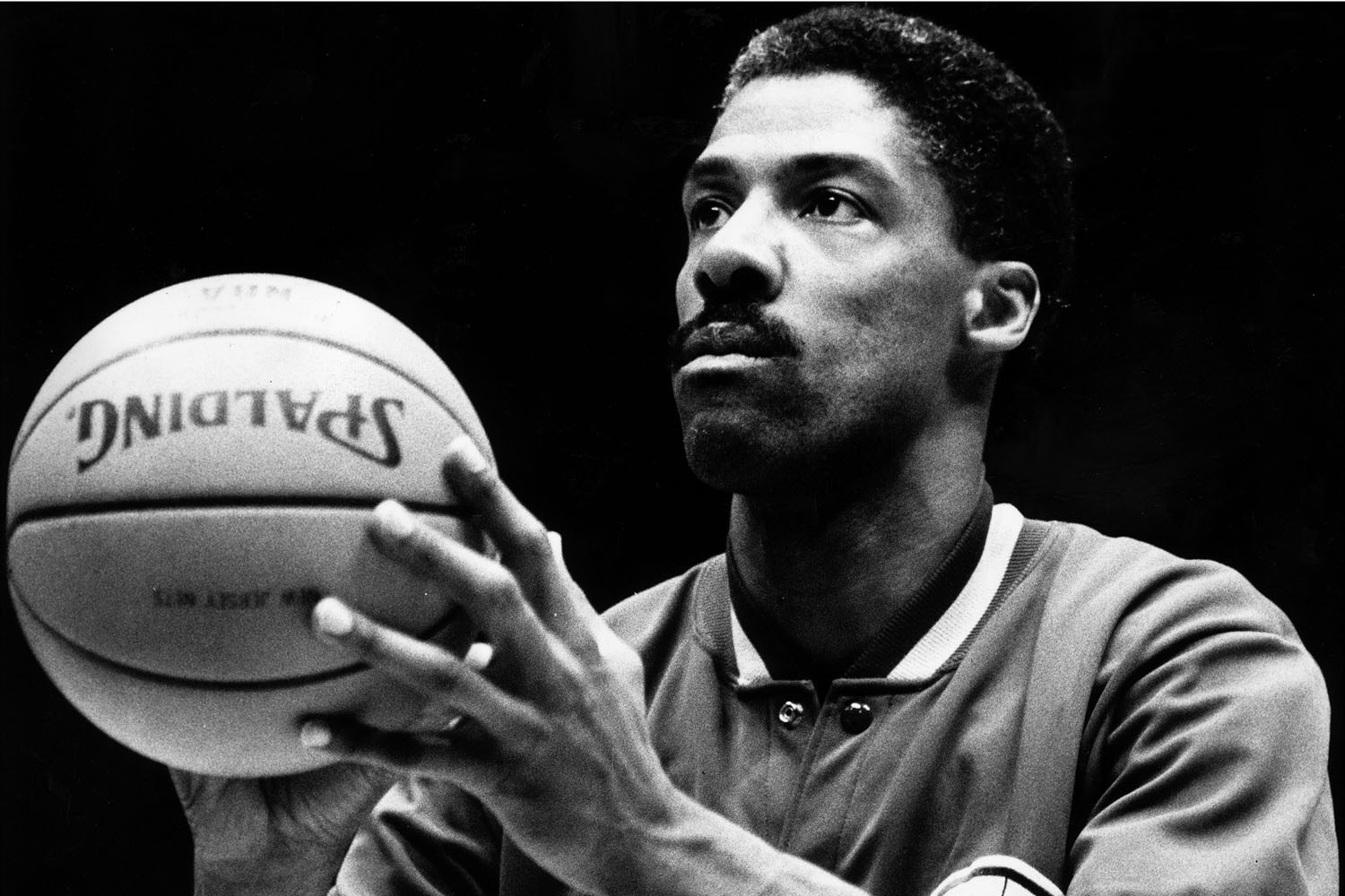 Philadelphia 76ers Julius Erving concentrates on his shooting as he warms up before a Nets game.