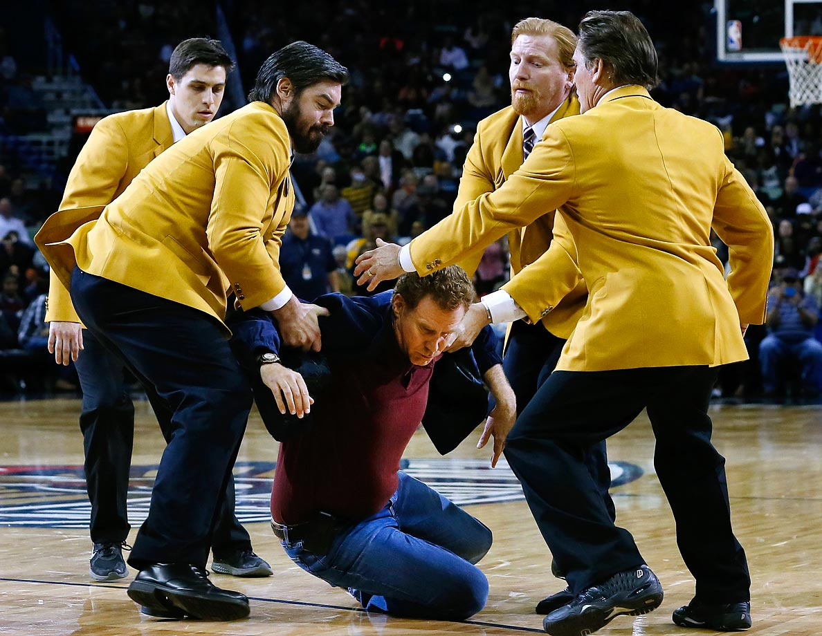 "Actor Will Ferrell is tackled by actors as part of a scene for the movie ""Daddy's Home."""