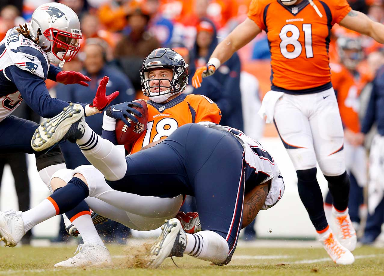 Peyton Manning is sacked in the second quarter by Alan Branch.