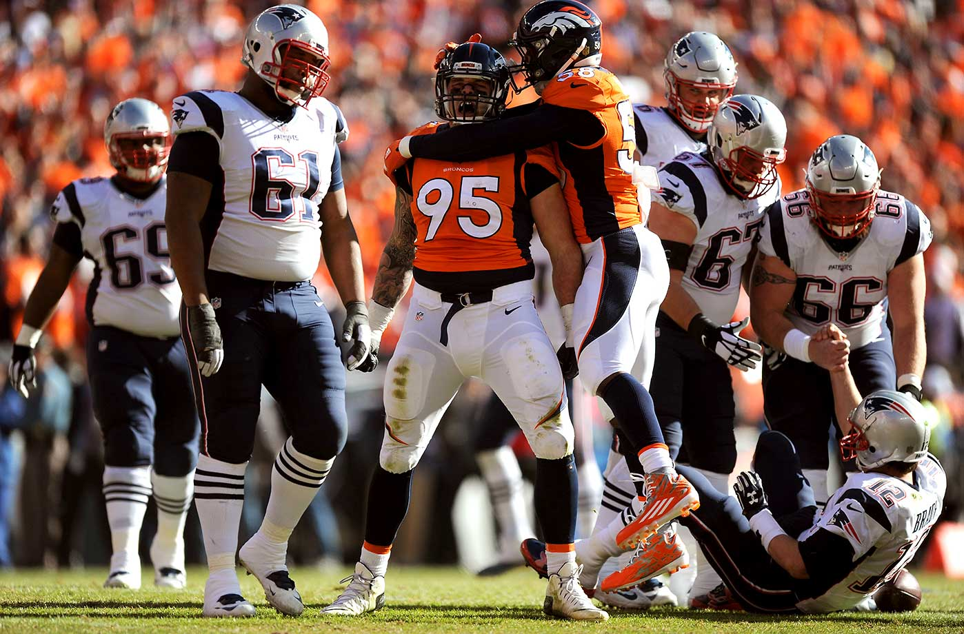 Derek Wolfe celebrates with Von Miller after a sack on Tom Brady.