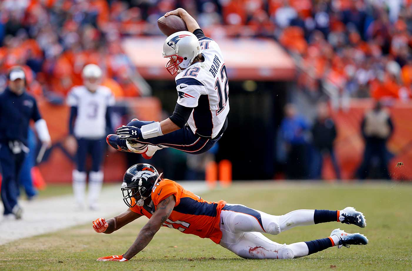 Tom Brady is tackled by Aqib Talib after an 11-yard scramble in the second quarter.