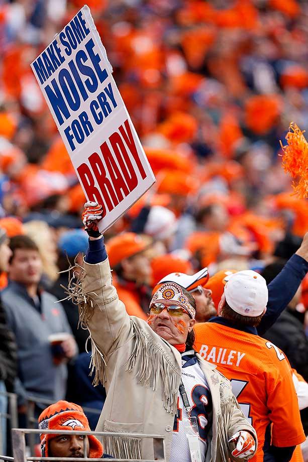 A Denver Broncos fan holds a sign.