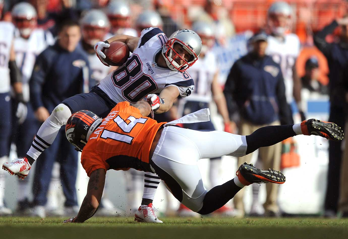 Cody Latimer tackles Danny Amendola in the third quarter.