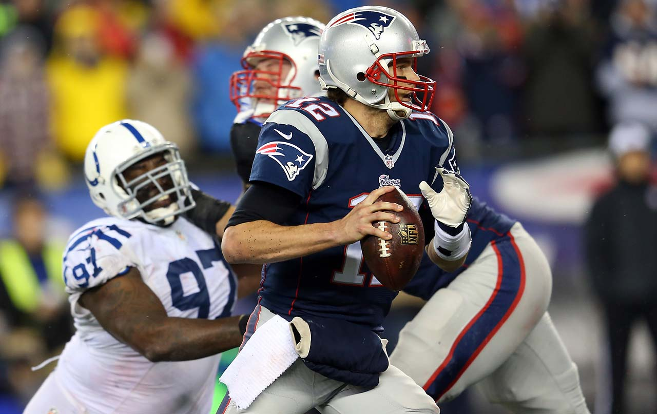Tom Brady looks to pass in the first half against the Colts.
