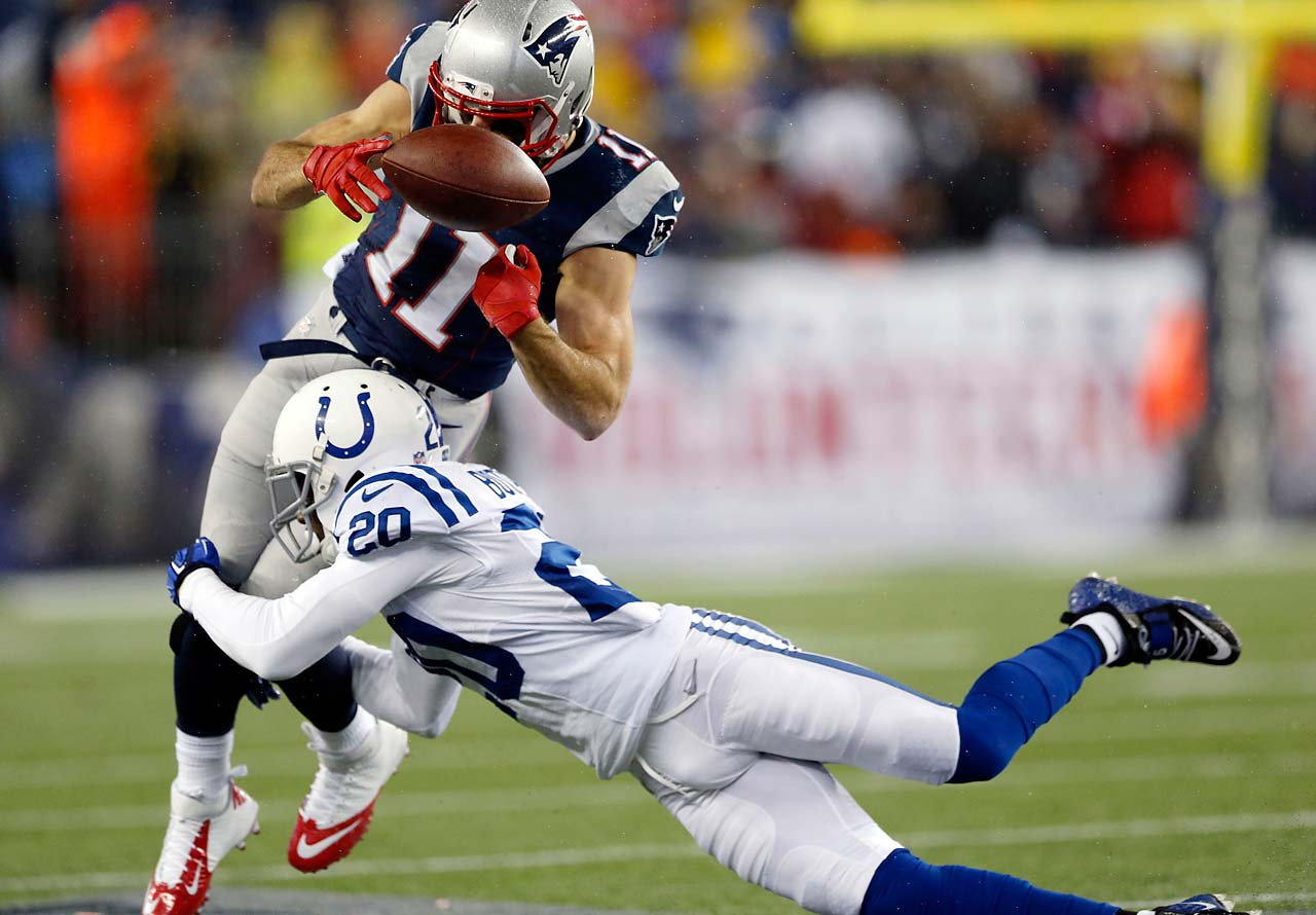 Julian Edelman is tackled by cornerback Darius Butler during the first half.