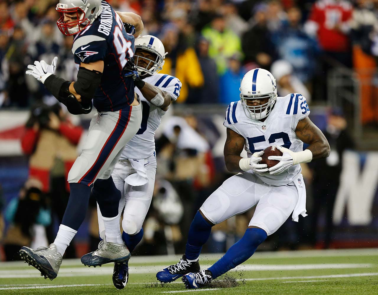Indianapolis Colts inside linebacker D'Qwell Jackson intercepts a pass intended for Rob Gronkowski during the first half.