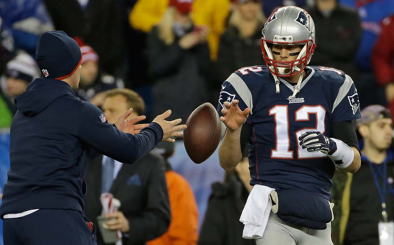 Tom Brady has a ball tossed to him during warmups before the AFC Championship game.