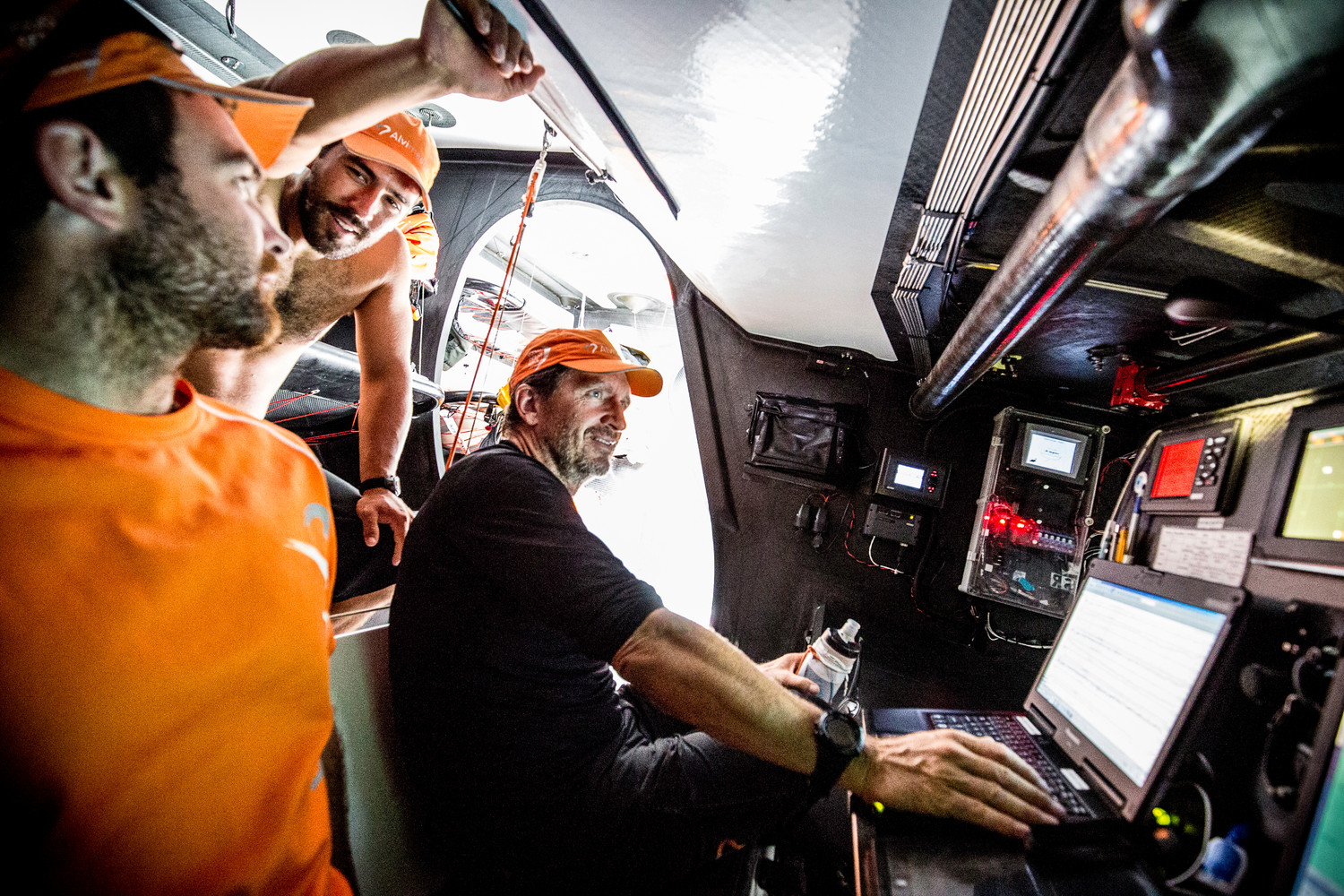 Skipper Charlie Enright (L), watch captain Mark Towill (M), and navigator Will Oxley (R) discuss the timing of the turn south.