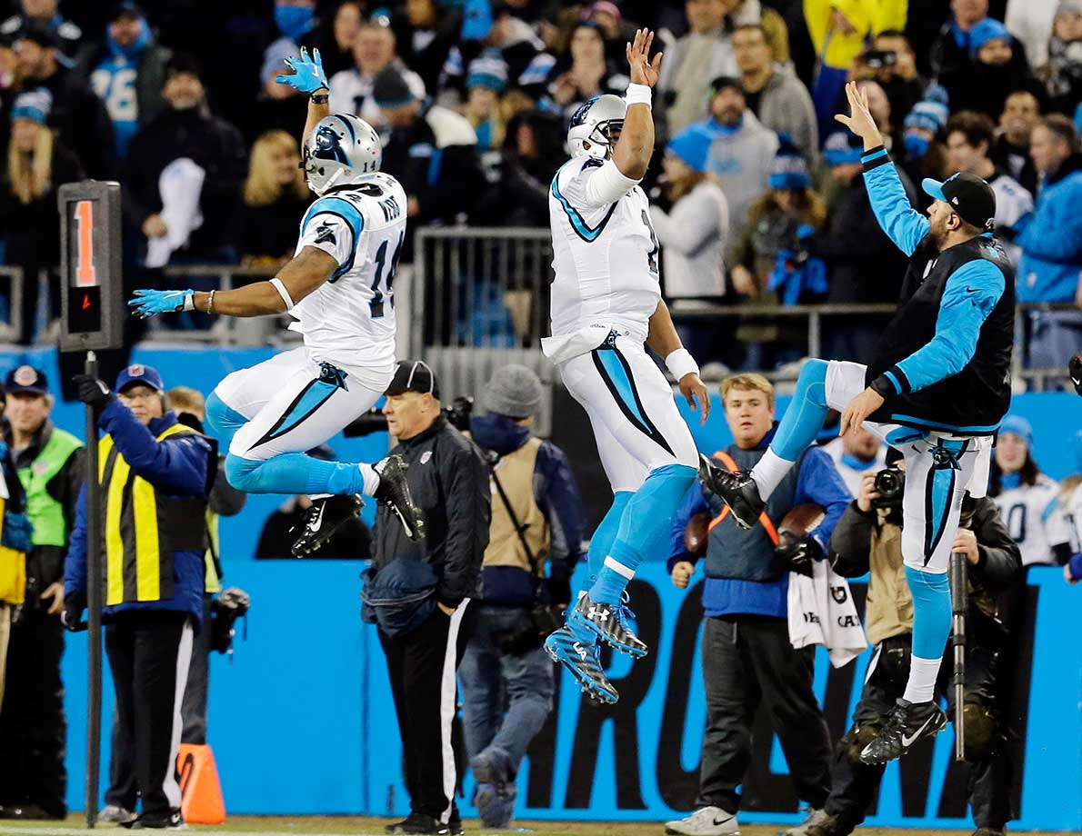 Cam Newton and Joe Webb celebrate a touchdown run during the first half.