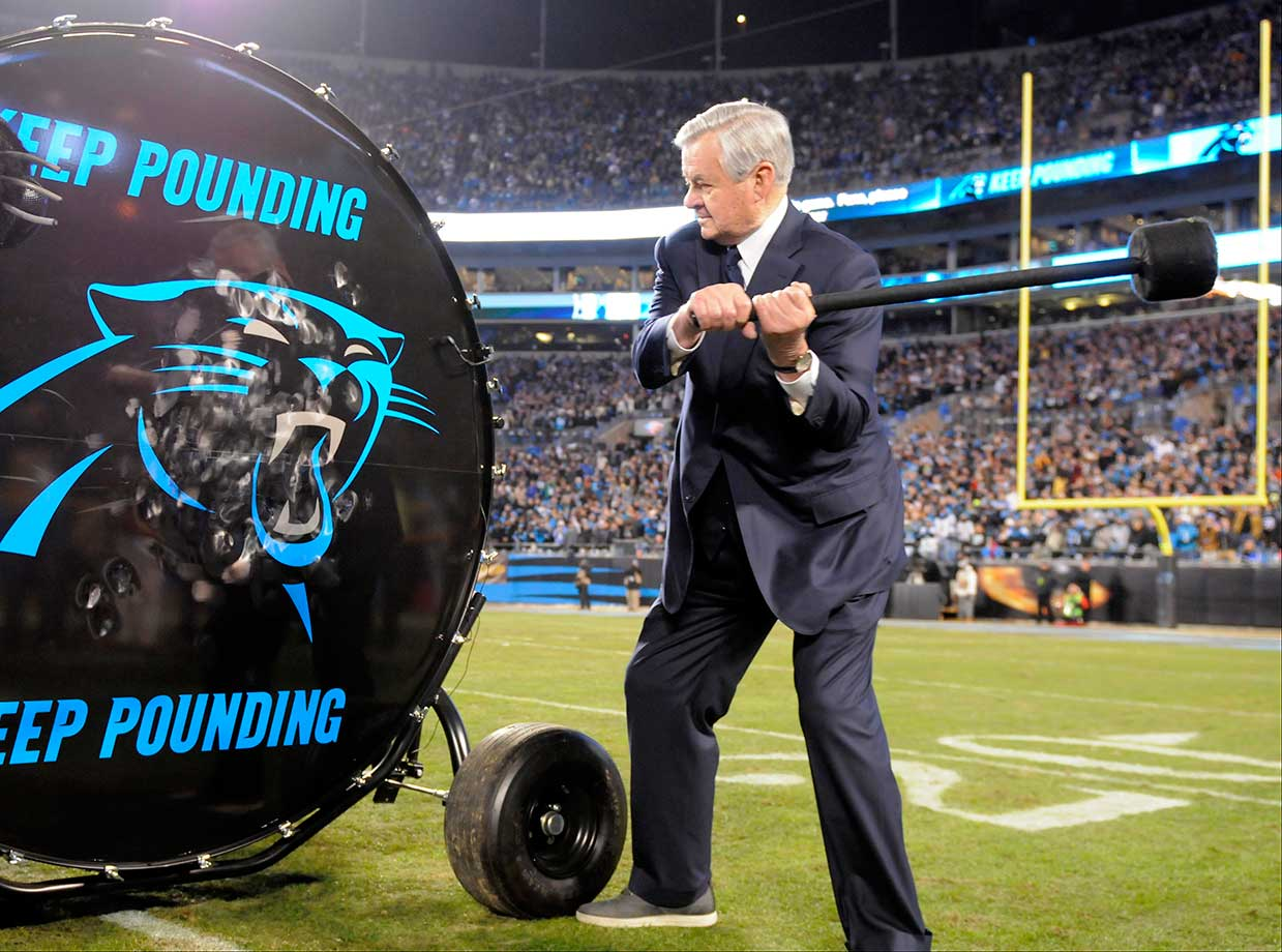 Carolina Panthers owner Jerry Richardson  hits a drum before the NFC title game.