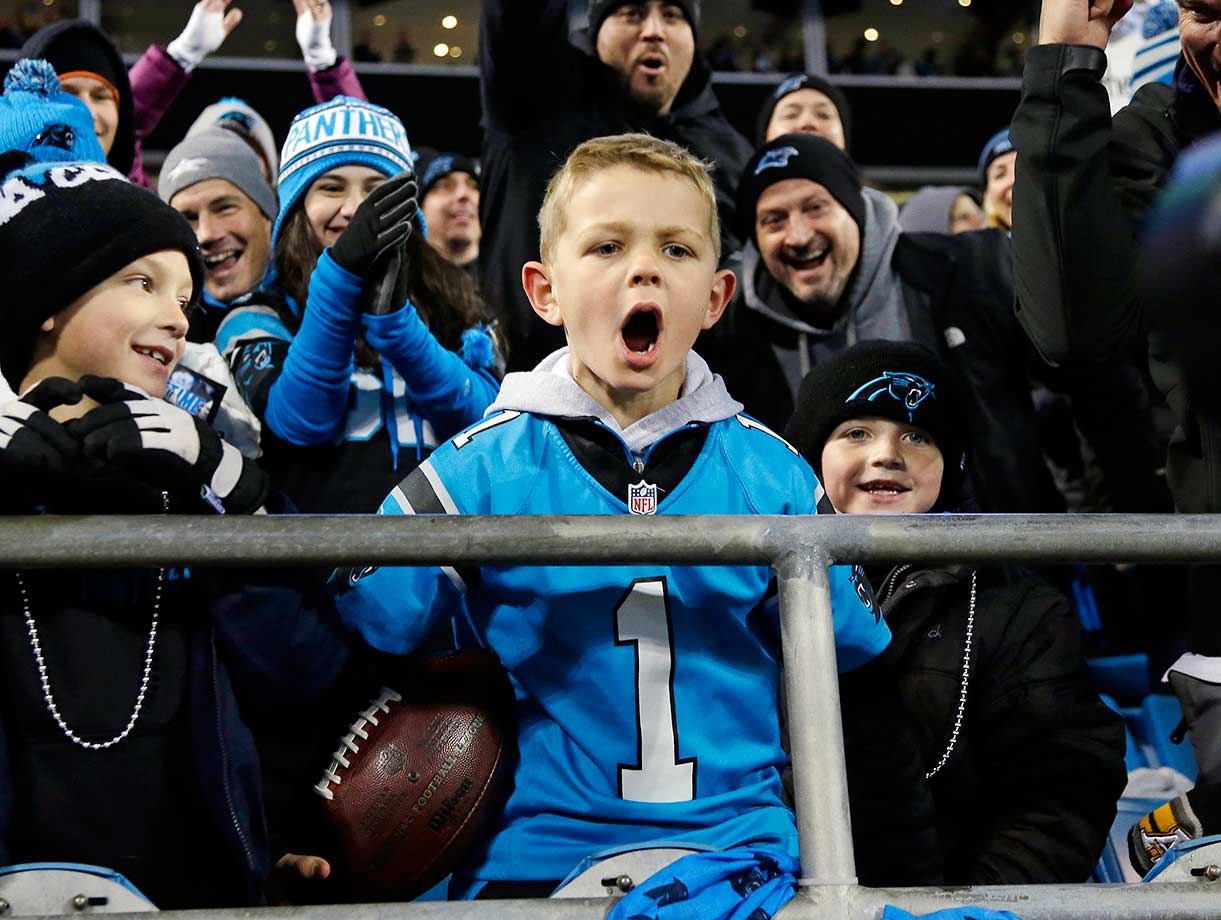 Seven-year-old Cameron Gandy celebrates after Carolina Panthers' Cam Newton gave him a touchdown ball.