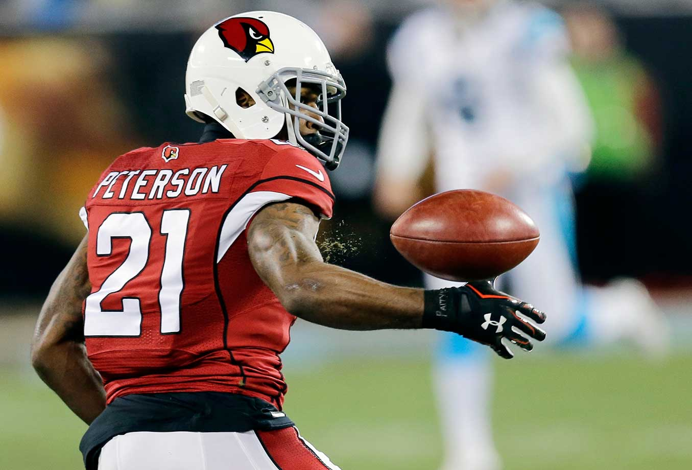 Patrick Peterson mishandled this punt and Carolina recovered the ball.