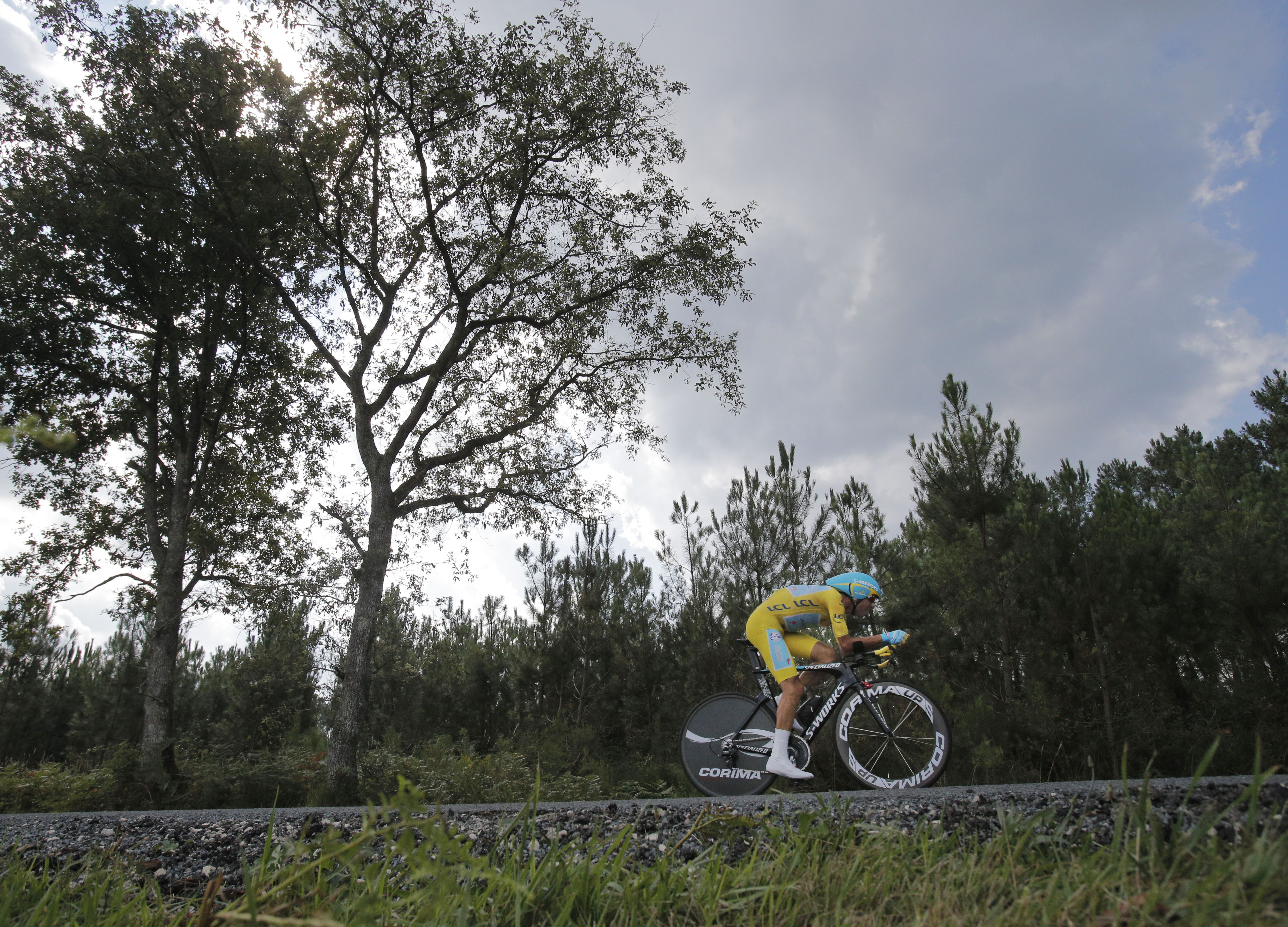 Italy's Vincenzo Nibali, wearing the overall leader's yellow jersey, strains during the twentieth stage.