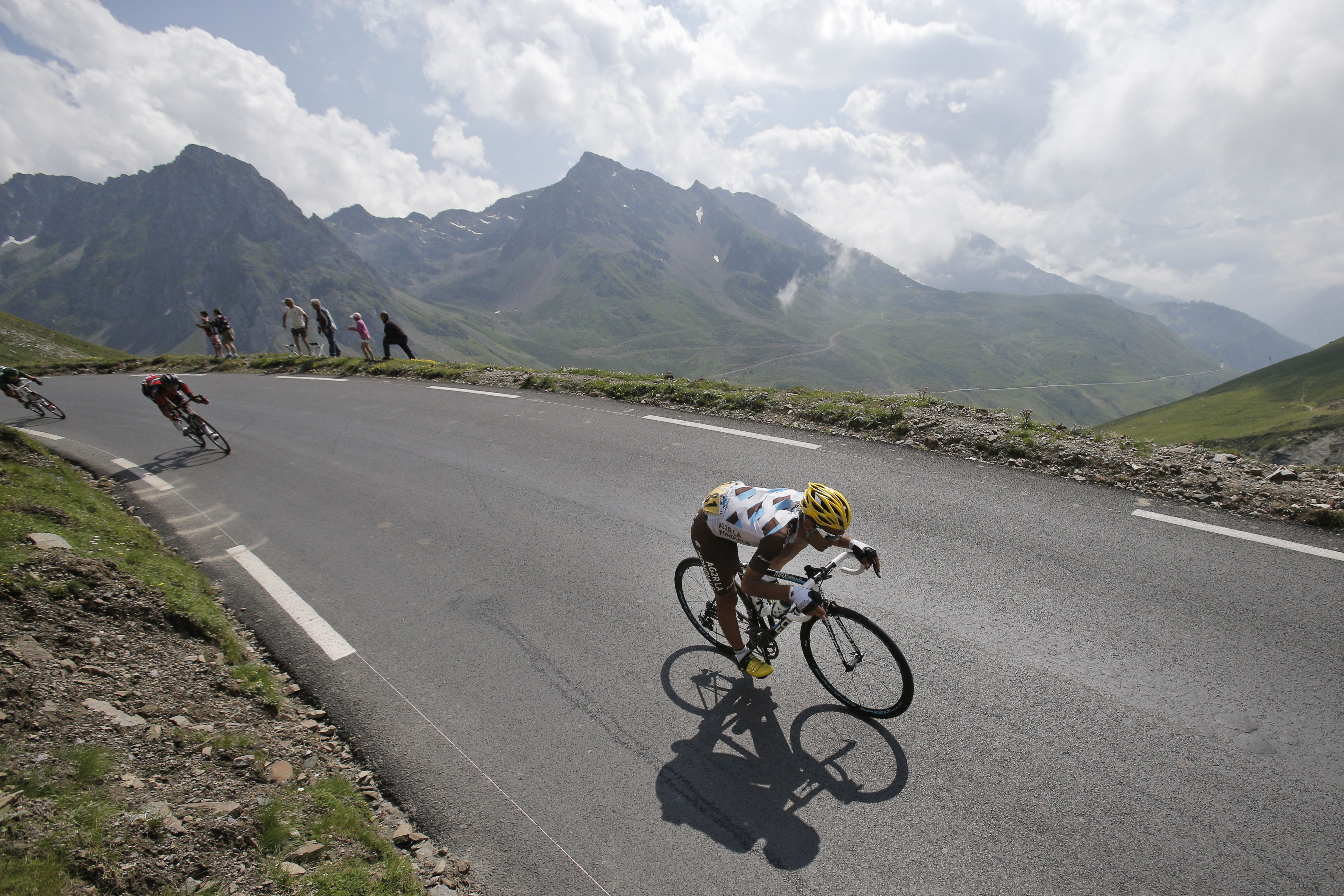 France's Jean-Christophe Peraud, front, speeds down Tourmalet pass during the eighteenth stage of the Tour de France.