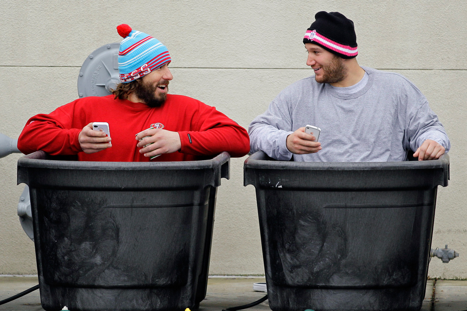 San Francisco 49ers guard Adam Snyder (L) and linebacker Blake Costanzo (R) take an ice bath after their practice in Santa Clara, California. The 49ers were preparing for their NFC Championship game against the New York Giants in late January 2012.