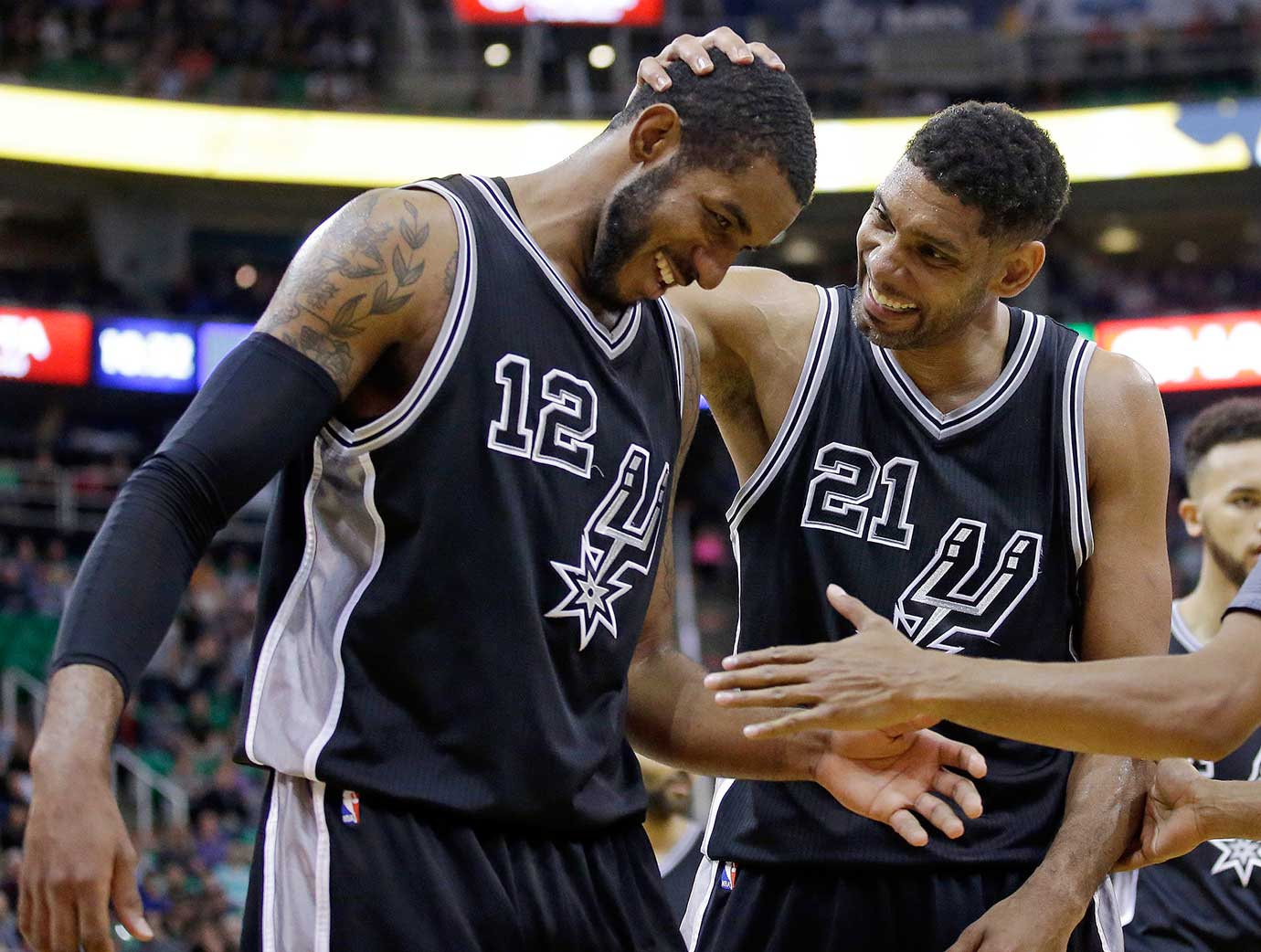 San Antonio center Tim Duncan (21) and LaMarcus Aldridge celebrate a 96-78 win at Utah.