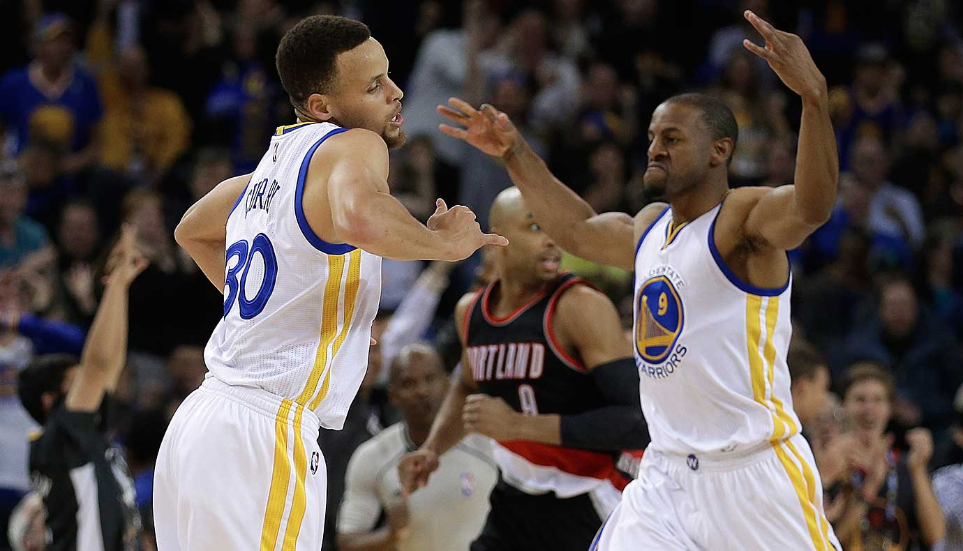 Stephen Curry and Andre Iguodala celebrate during an 81-point first-half scoring barrage against the Portland Trail Blazers.