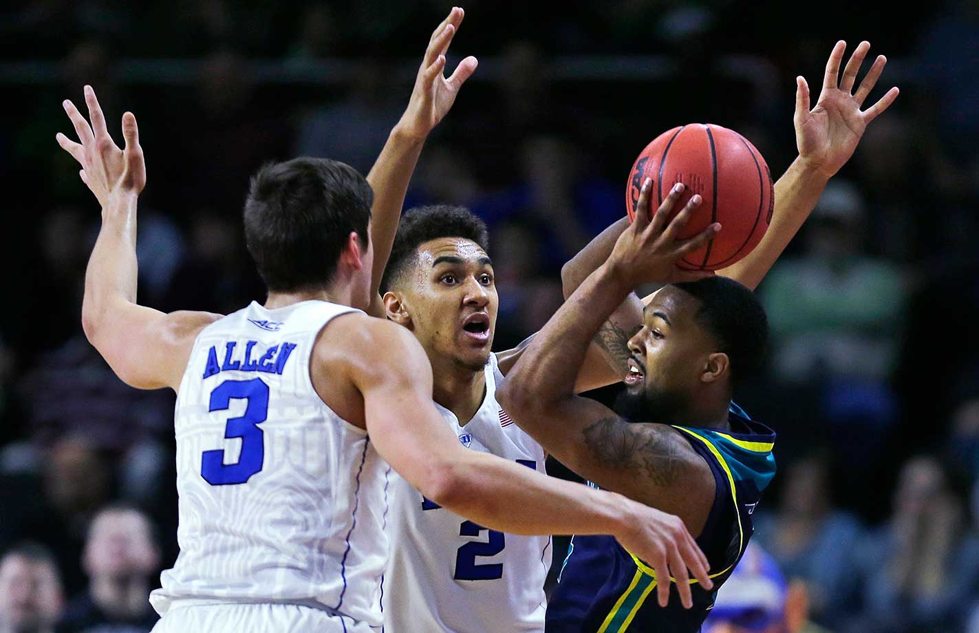 North Carolina-Wilmington's Jordon Talley is trapped by Grayson Allen (3) and Chase Jeter of Duke.
