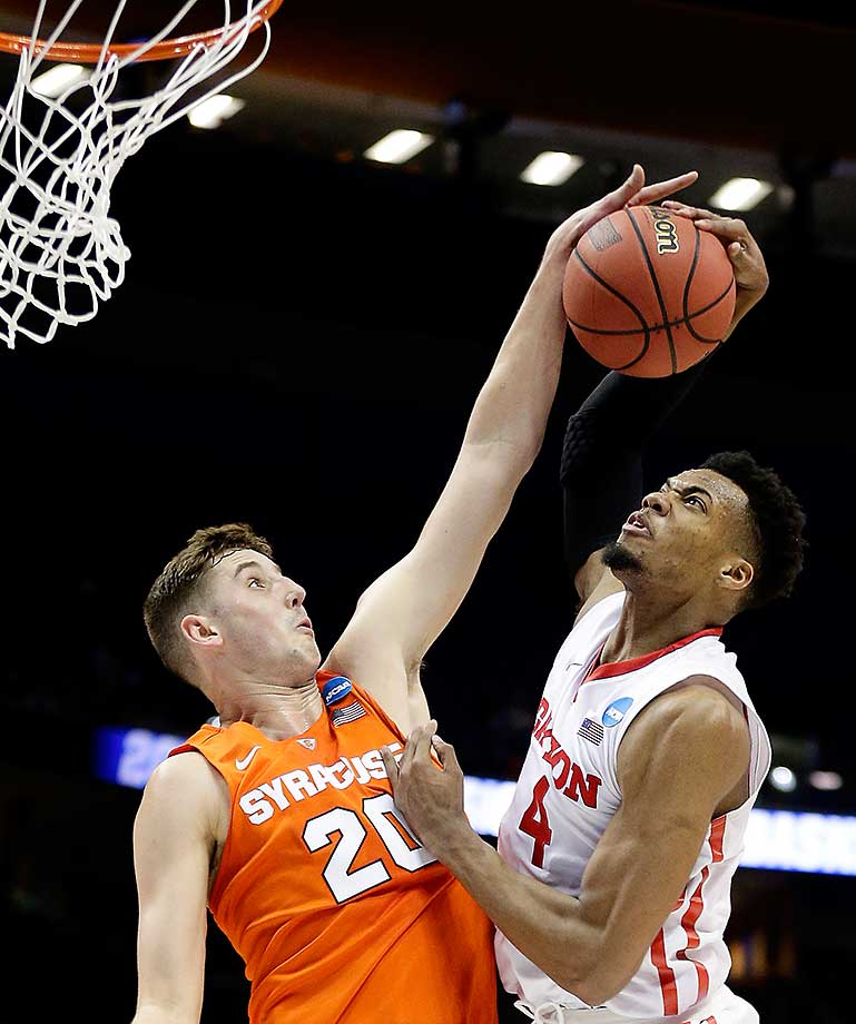 Syracuse's Tyler Lydon blocks a shot by Dayton's Charles Cooke during a 70-51 win by the Orange.