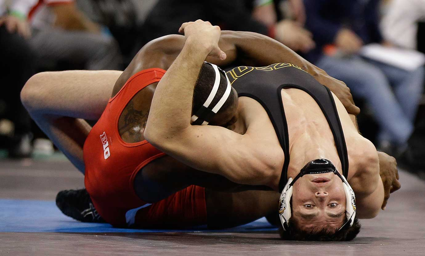 Missouri's Willie Miklus, right, and Nebraska's Timothy Dudley compete in a 184-pound match during the semifinals of the NCAA Division I wrestling championships in New York.
