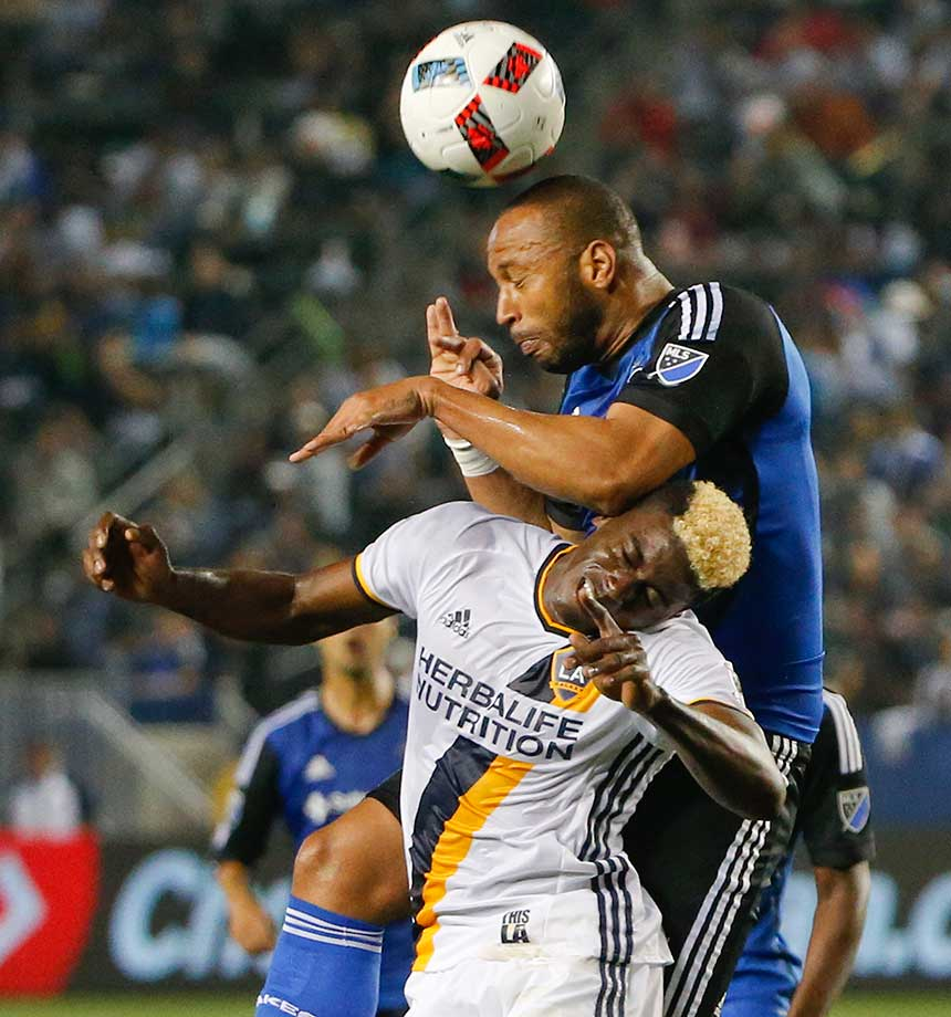 San Jose Earthquake's Fatai Alashe gets on top of Los Angeles Galaxy's Gyasi Zerdes while hitting a header. The Galaxy won 3-1.